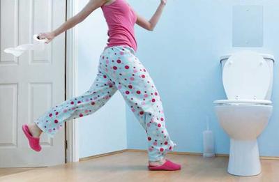 colitis diarrhea woman running to toliet