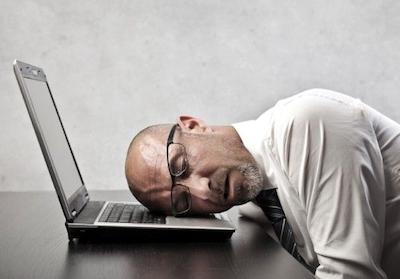 Idiopathic Hypersomnia man sleeping on laptop