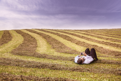 allergy man laying in hay field