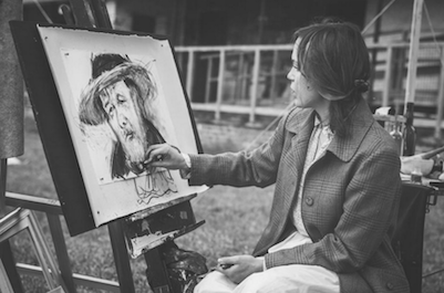 ibd woman painting mans sad face